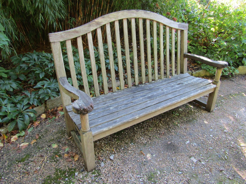 A weathered teak wood garden bench, 160cm wide