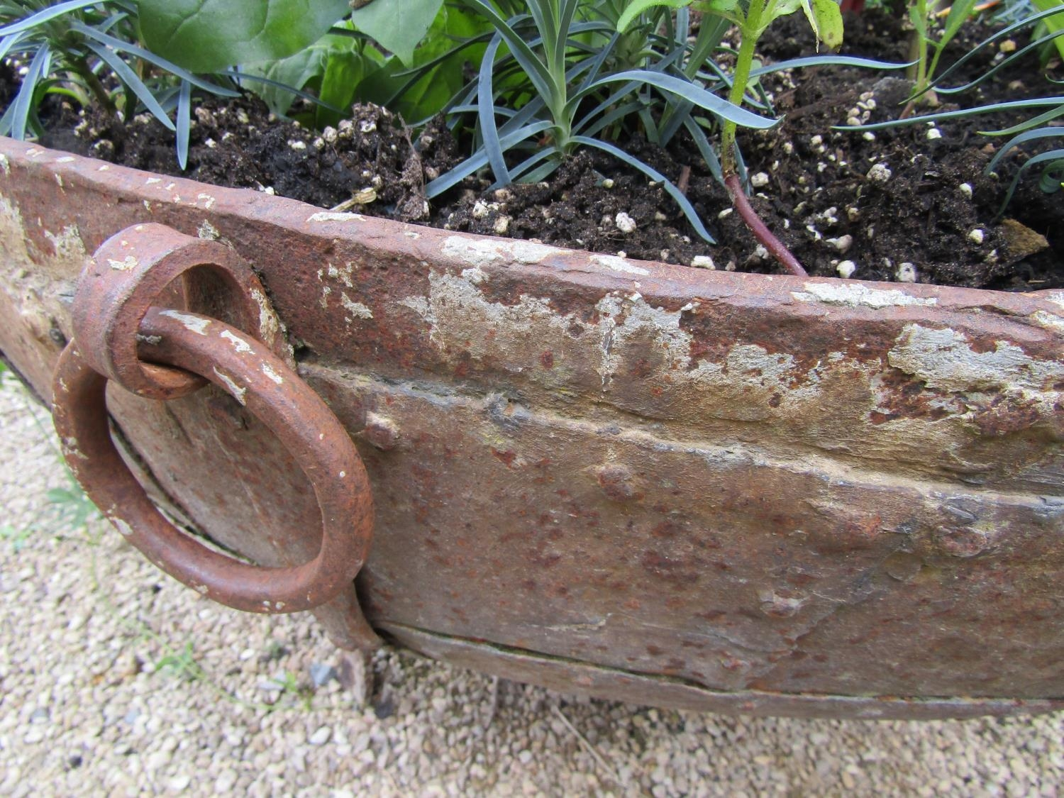A riveted iron cauldron with ring handles, raised on a later base with scrolled supports, 110cm - Image 3 of 3