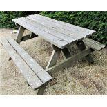 A weathered teak picnic bench, 152cm long