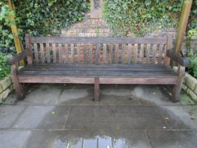 A good quality weathered teak park bench, 240cm wide