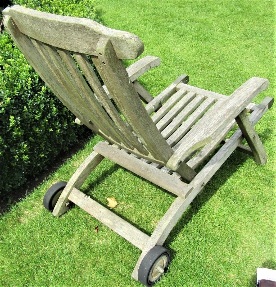 A weathered teak garden reclining chair, mounted on a single axle (lacks foot rest) - Image 2 of 2