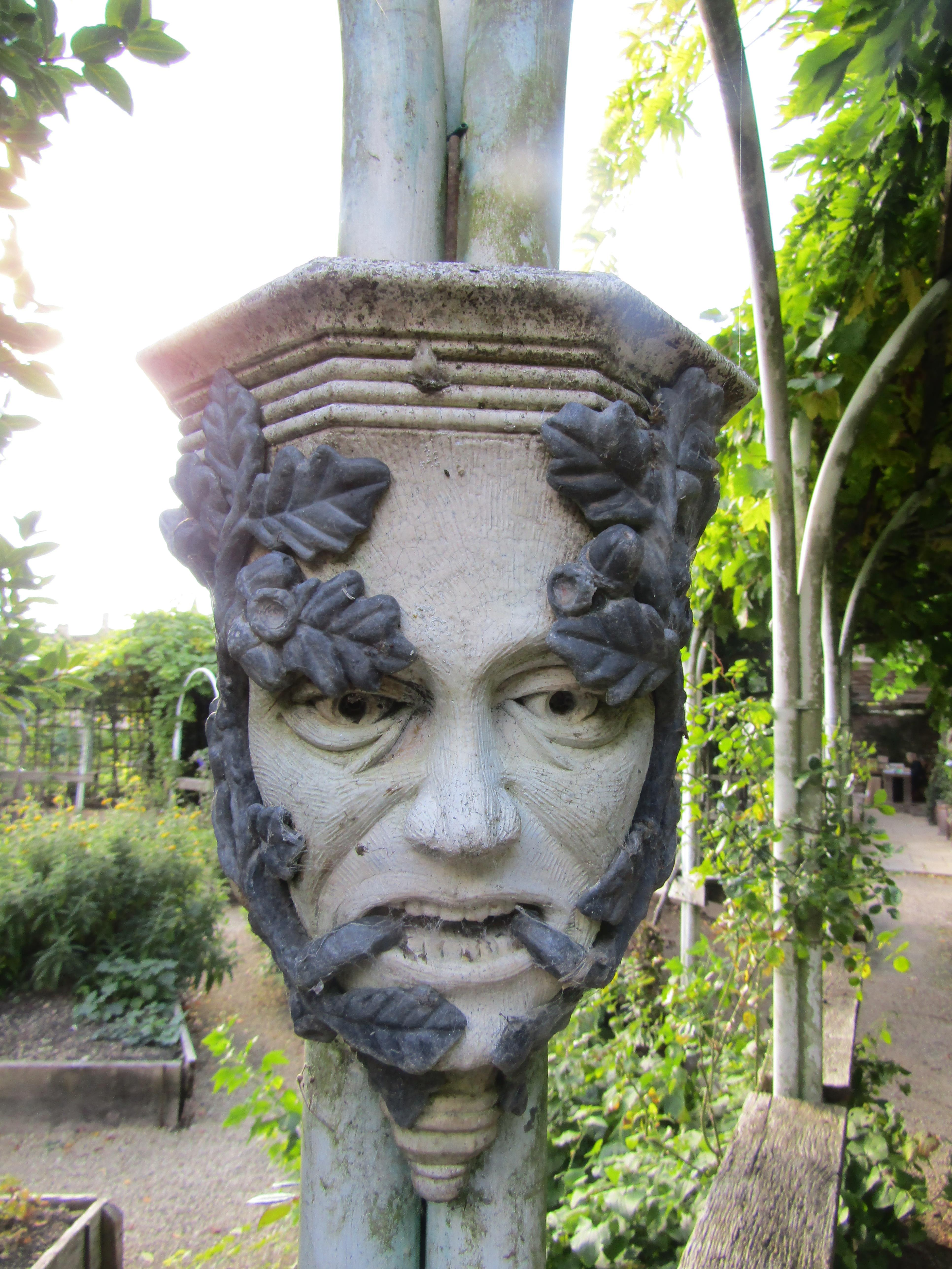 Pair of reconstituted stone green man wall bosses overlaid in lead - Image 2 of 3