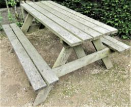 A weathered teak picnic table, 152cm long
