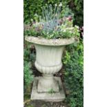 A reclaimed campana shaped garden urn with fluted panels, within egg and tongue borders, 75cm high