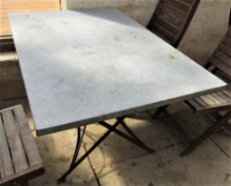 A vintage style café table, the rectangular top zinc lined, 120cm x 80cm, raised on an ironwork base