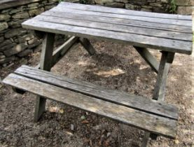 A weathered teak picnic table, 122cm long