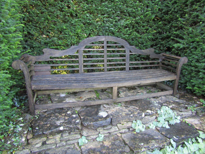 An old teak garden bench in the Lutyens manner (some restoration required) 260cm wide