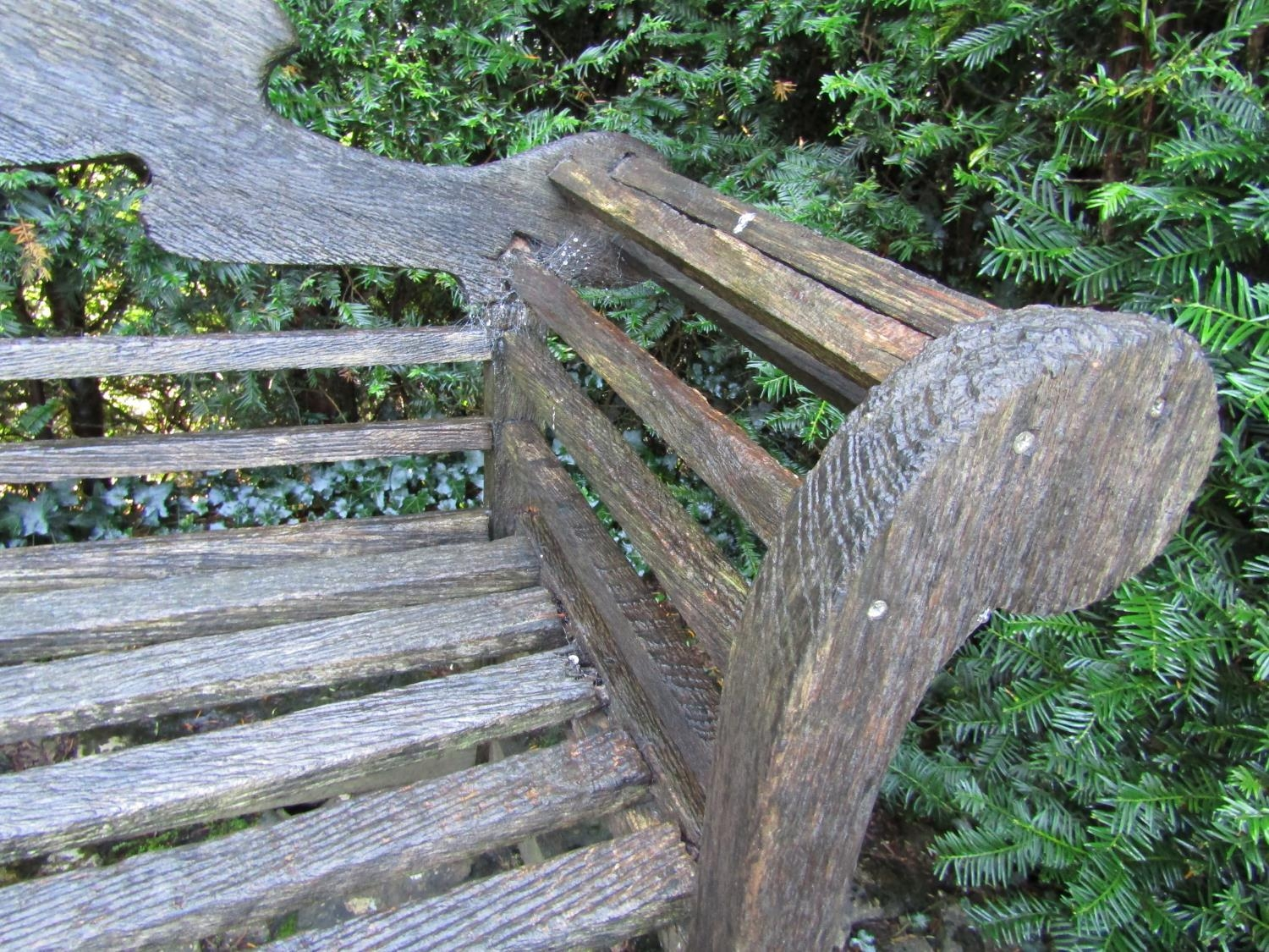 An old teak garden bench in the Lutyens manner (some restoration required) 260cm wide - Image 2 of 2