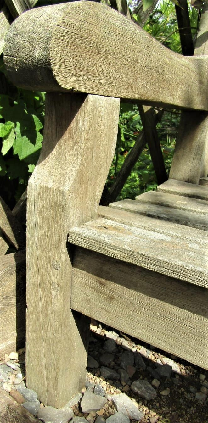 A weathered teak wood garden bench, 240cm wide, reduced in height - Image 2 of 2