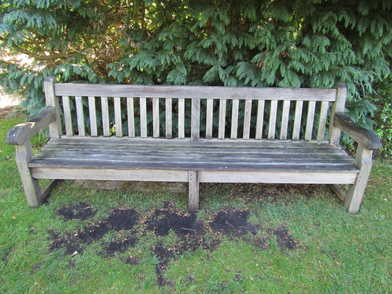 A good weathered teak wood garden bench, 240cm wide