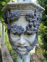 Pair of reconstituted stone green man wall bosses overlaid in lead