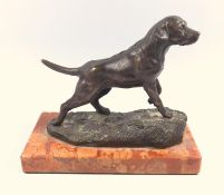 Bronze figure of a Labrador gun dog on red marble base, 20 th C, height 16 cm