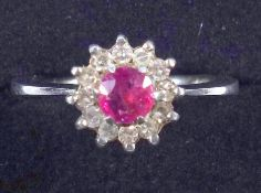 Vintage ruby and diamond cluster ring, in 18ct white gold, ring size M, 3.7 grams