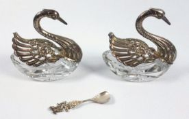 A pair of silver and crystal swan salts, H. 7cm, L. 7cm, Wingspan 9cm, with a silver salt spoon, the