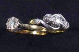 An illusion set three stone diamond ring on 18 ct band, size H and similar single stone ring size K
