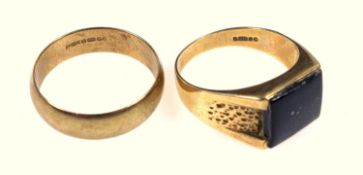 Two gold rings, gold wedding band, and a gentleman's onyx set signet ring, both 9 ct, size W.