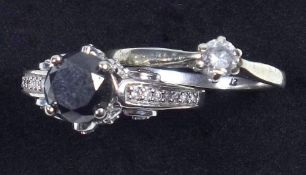 White gold ring set with black diamond and diamond set mount and shoulders, ring size K 1/2 and a