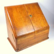Victorian oak stationery cabinet, the two doors opening to reveal a letter rack and pen tray, 27 x