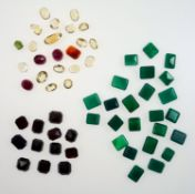 Loose gem stones, three rubies, citrine and clear quartz, chalcedony and others.