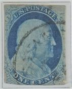Benjamin Franklin 1 cent stamp, other early United States of America postage stamps contained in a