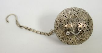 Chinese white metal pierced diffuser or tea ball, circular hinged form with incised and pierced