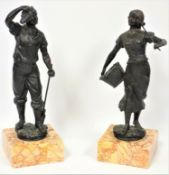 A pair of 19th C. French spelter figures, the girl carrying a basket of fruit, the boy holding a