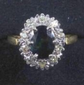Sapphire and diamond cluster ring, set with an oval sapphire and brilliant cut diamonds, 18 ct white