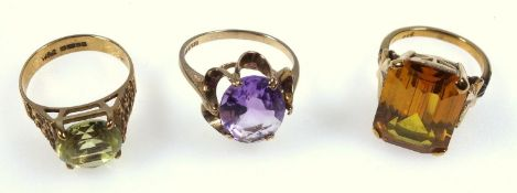 Three vintage dress rings,an amethyst set ring, another with lemon quartz, and one other, all marked