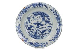 A blue and white porcelain deep charger with a scalloped rim, decorated with two ducks in a lotus