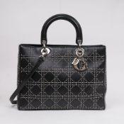 Christian Dior. Lady Dior Bag Schwarz mit Nieten.