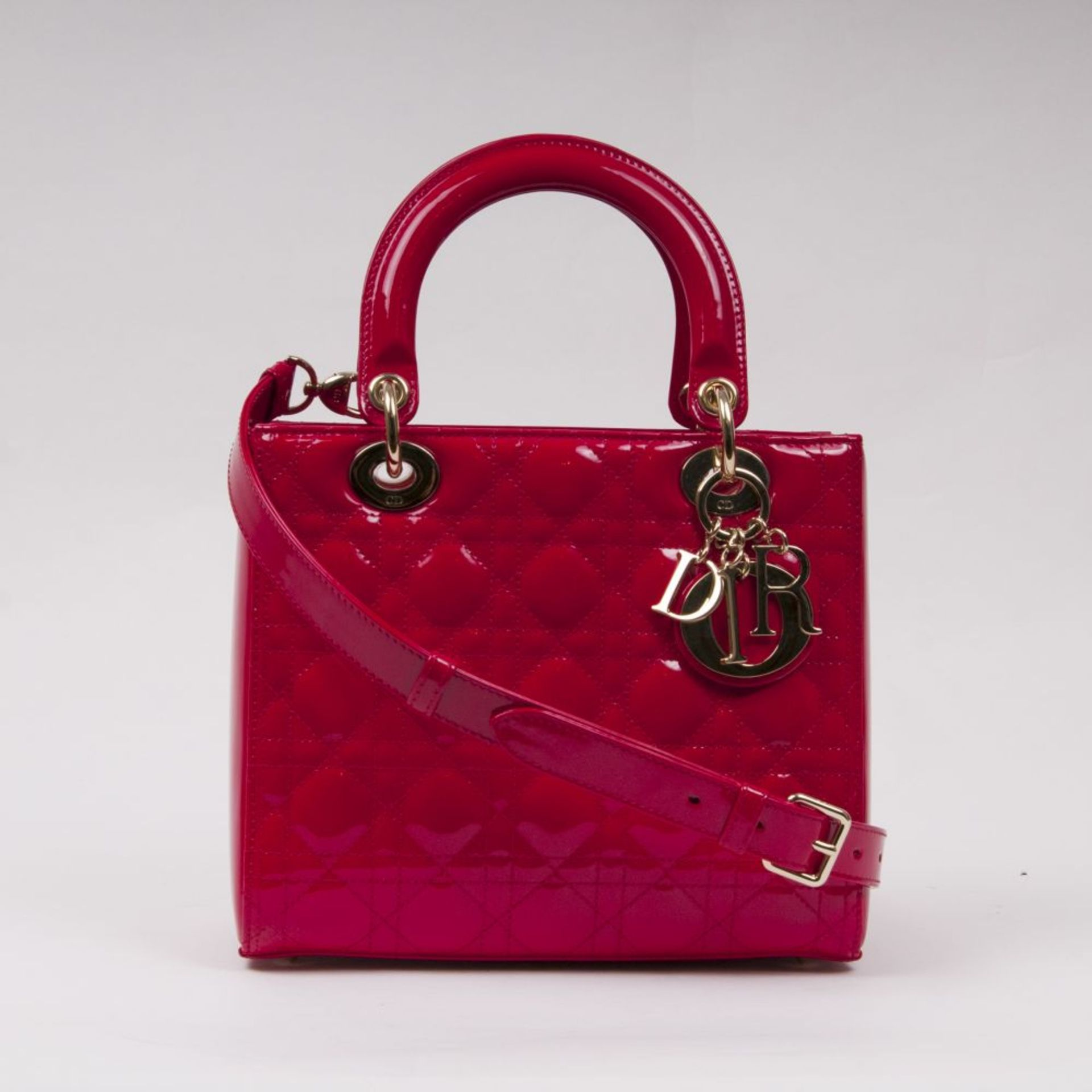 Christian Dior. Lady Dior Bag Kirschrot.