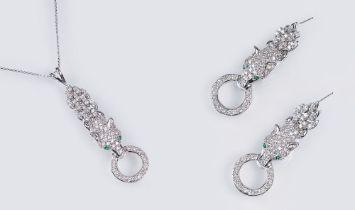 Paar Brillant-Smaragd-Ohrringe 'Panther' mit passendem Anhänger an Kette. 14 kt. WG, gest. Dichter
