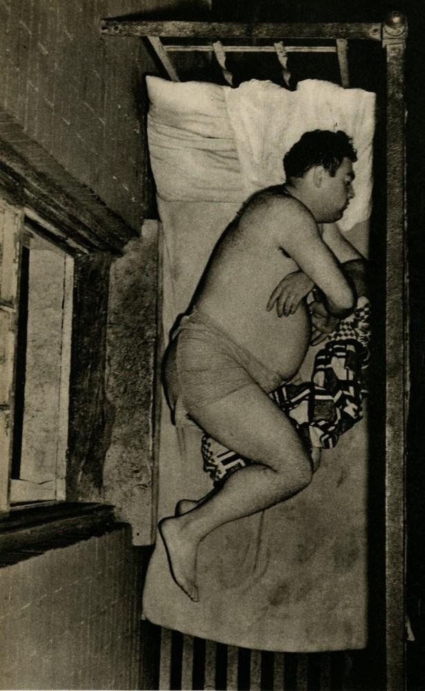 WEEGEE [arthur h. fellig] - Man Sleeping on a Fire Escape - Original vintage photogravure