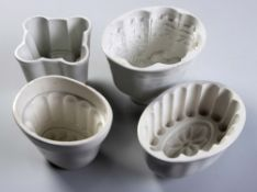 A COLLECTION OF FOUR VICTORIAN PORCELAIN JELLY MOULDS