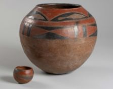 AN EARTHENWARE POT, VENDA