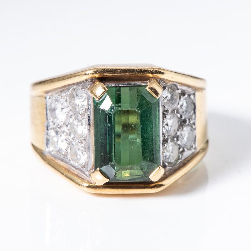 A GREEN TOURMALINE AND DIAMOND RING