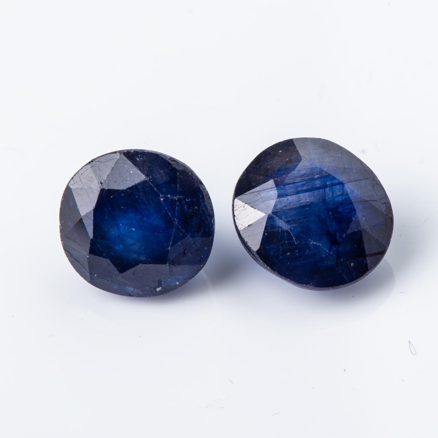 A PAIR OF UNSET SAPPHIRES