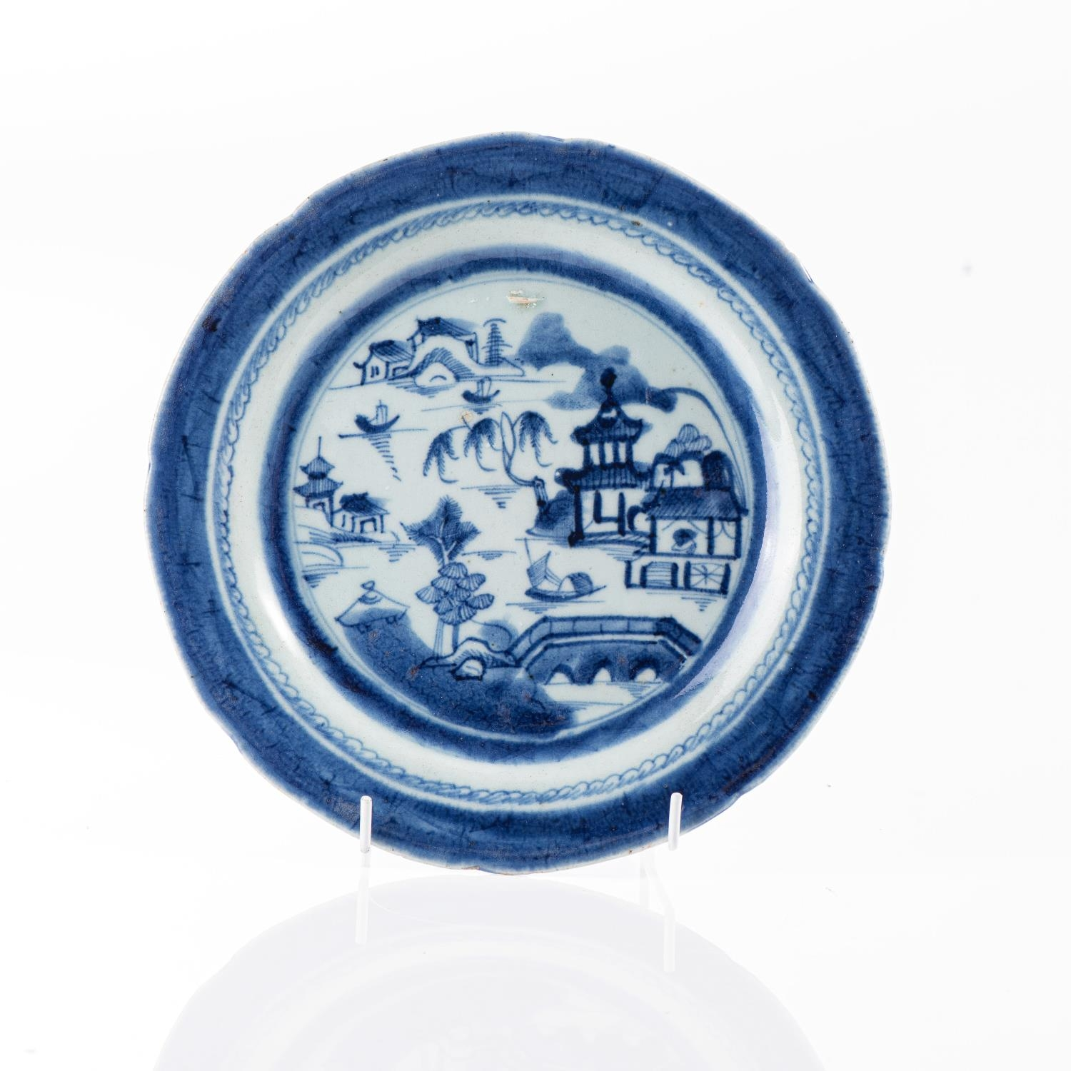 A CHINESE BLUE AND WHITE RIVER LANDSCAPE PLATE, QING DYNASTY, 19TH CENTURY