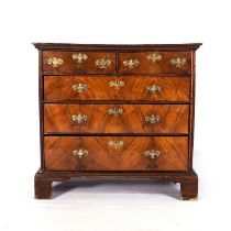 A GEORGE III WALNUT CHEST-OF-DRAWERS