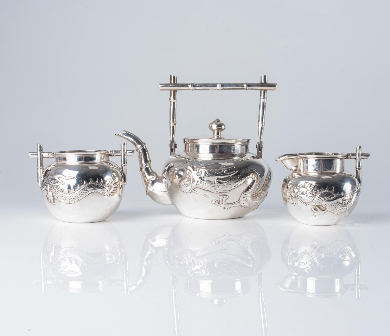 A CHINESE SILVER THREE-PIECE TEA SET