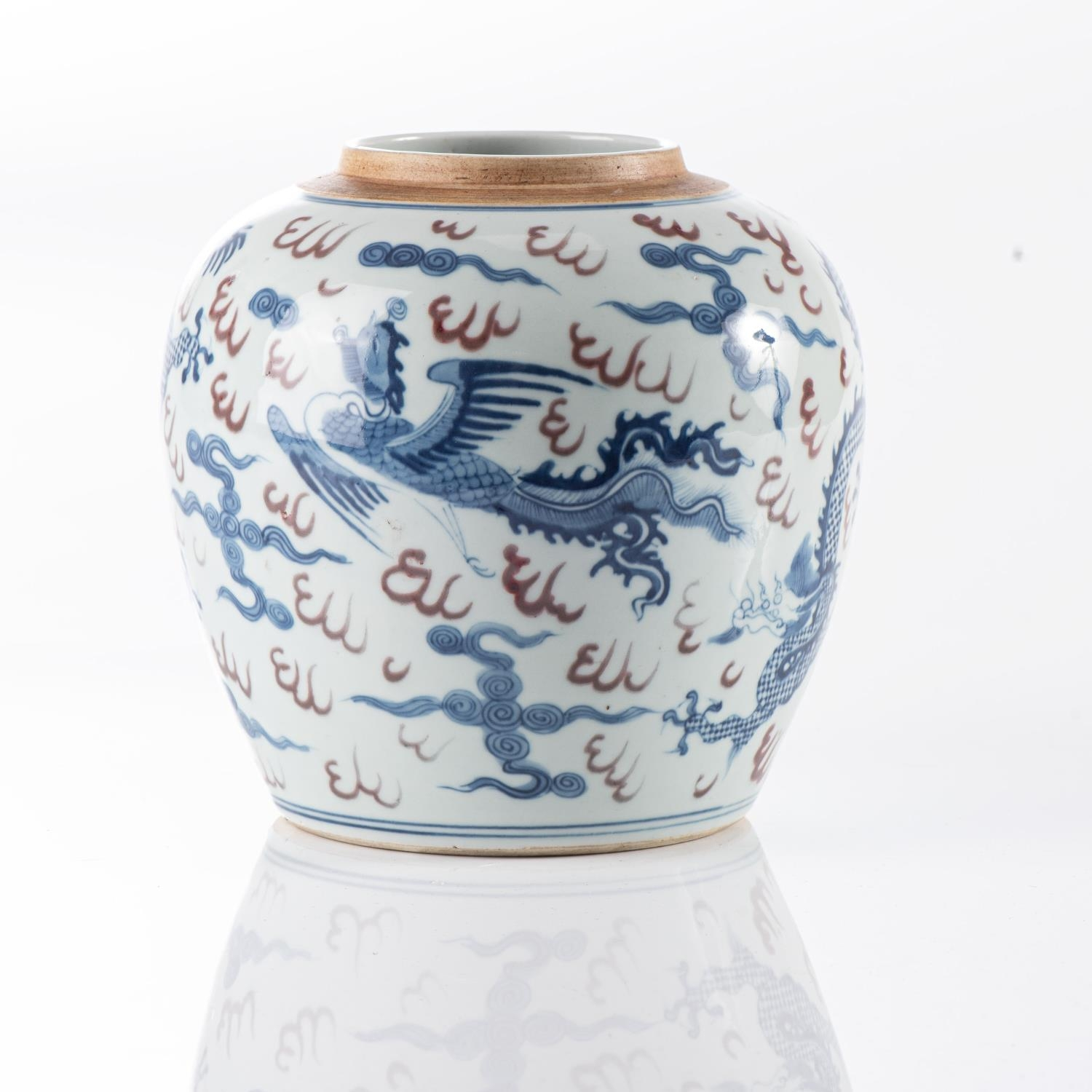 A CHINESE BLUE AND WHITE DRAGON AND PHOENIX GINGER JAR