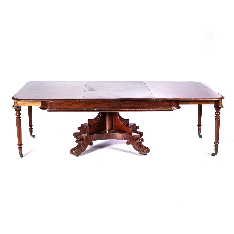 A MAHOGANY EXTENDING DINING TABLE, 19TH CENTURY