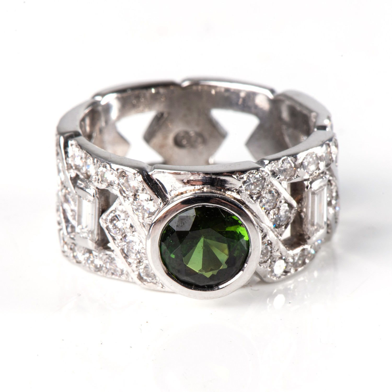 A DIAMOND AND GEMSTONE DRESS RING