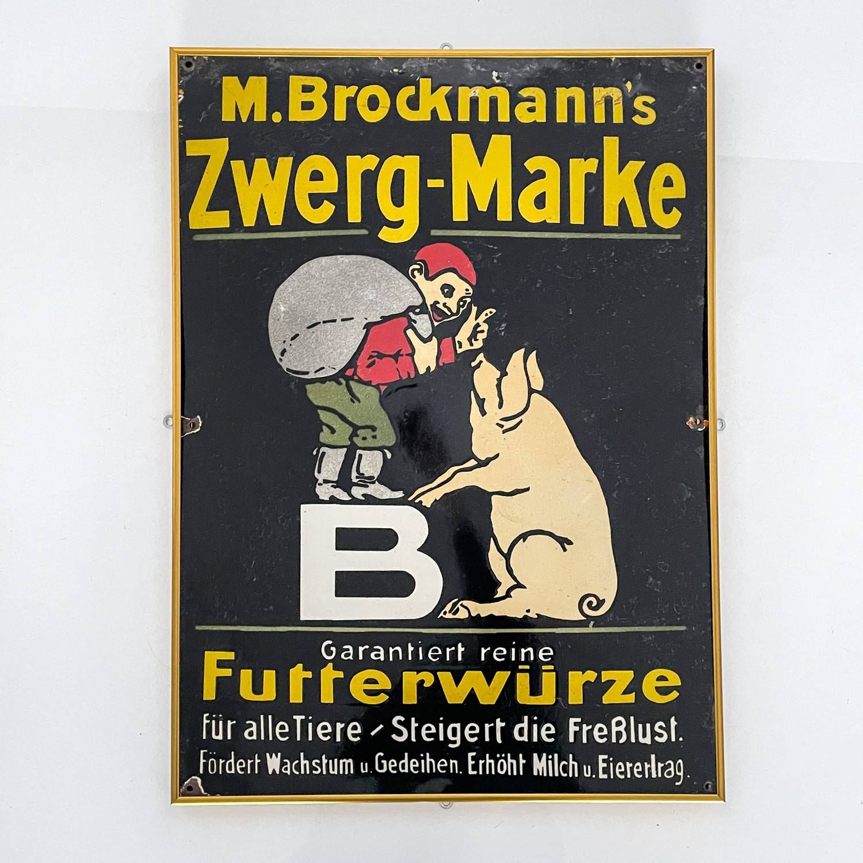 AN ENAMEL M. BROCKMANN'S ZWERG-MARKE SIGN, CIRCA 1930