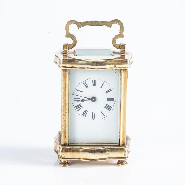 A BRASS CARRIAGE CLOCK