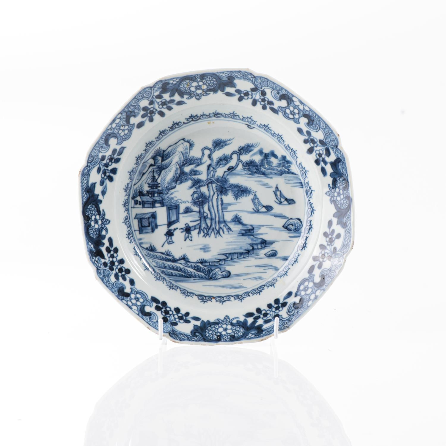 A CHINESE BLUE AND WHITE PINE AND PAGODA PLATE, QING DYNASTY, 18TH CENTURY