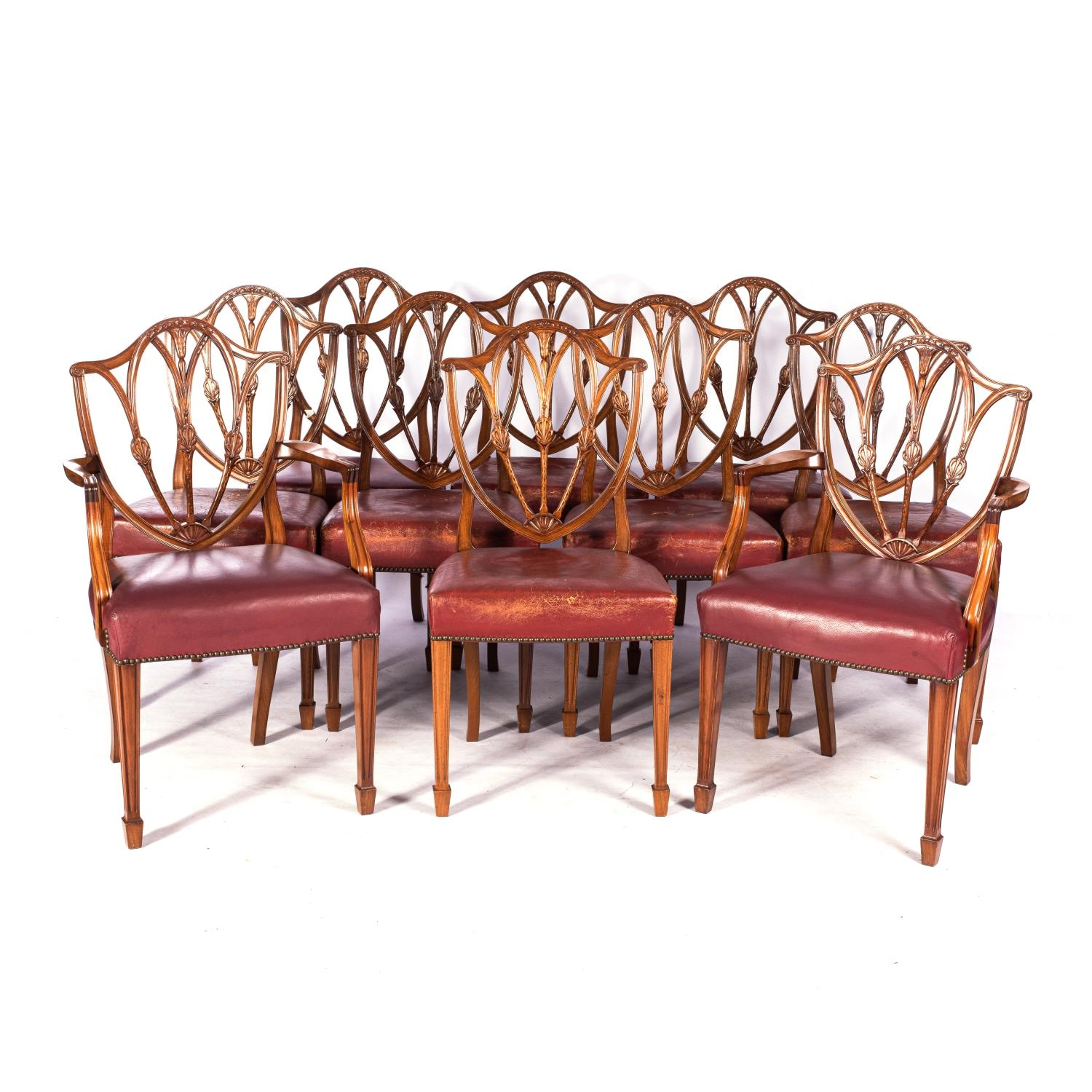 A SET OF TEN HEPPLEWHITE STYLE MAHOGANY DINING CHAIRS