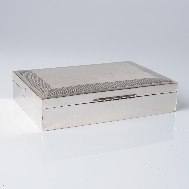 A SILVER CIGARETTE BOX