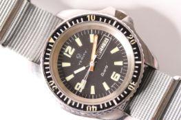 VINTAGE VERITY DIVE WRISTWATCH CIRCA 1980s, circular black dial, block luminous hour markers, day