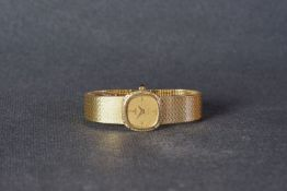 LADIES OMEGA DE VILLE 18CT GOLD DIAMOND SET WRISTWATCH, rounded gold linen dial with hour markers